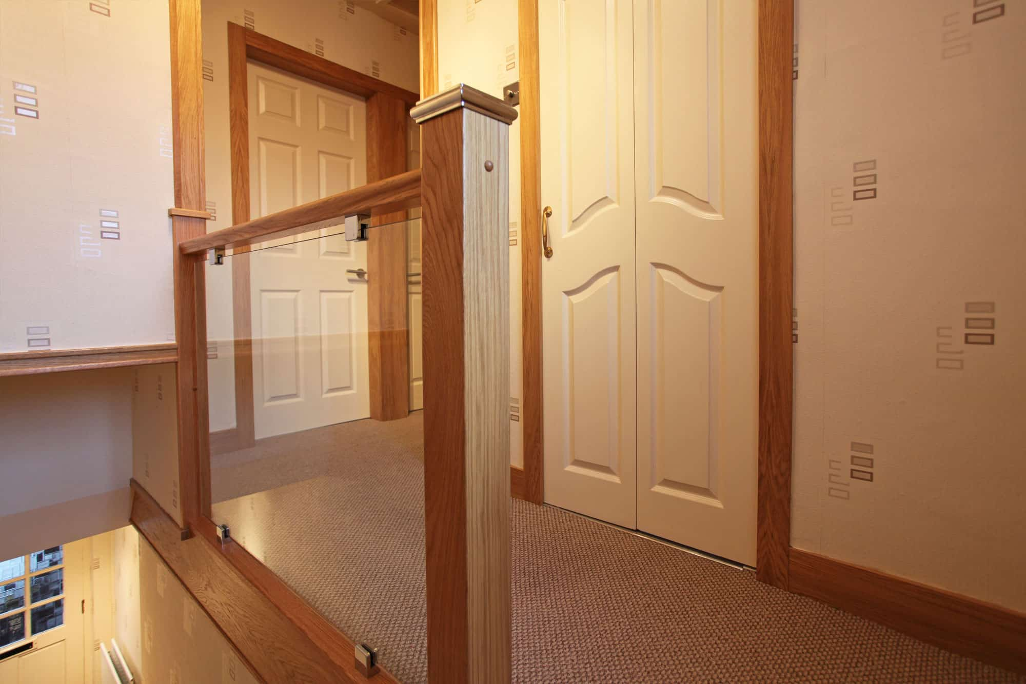 Oak and glass staircase with oak skirting boards and architrave