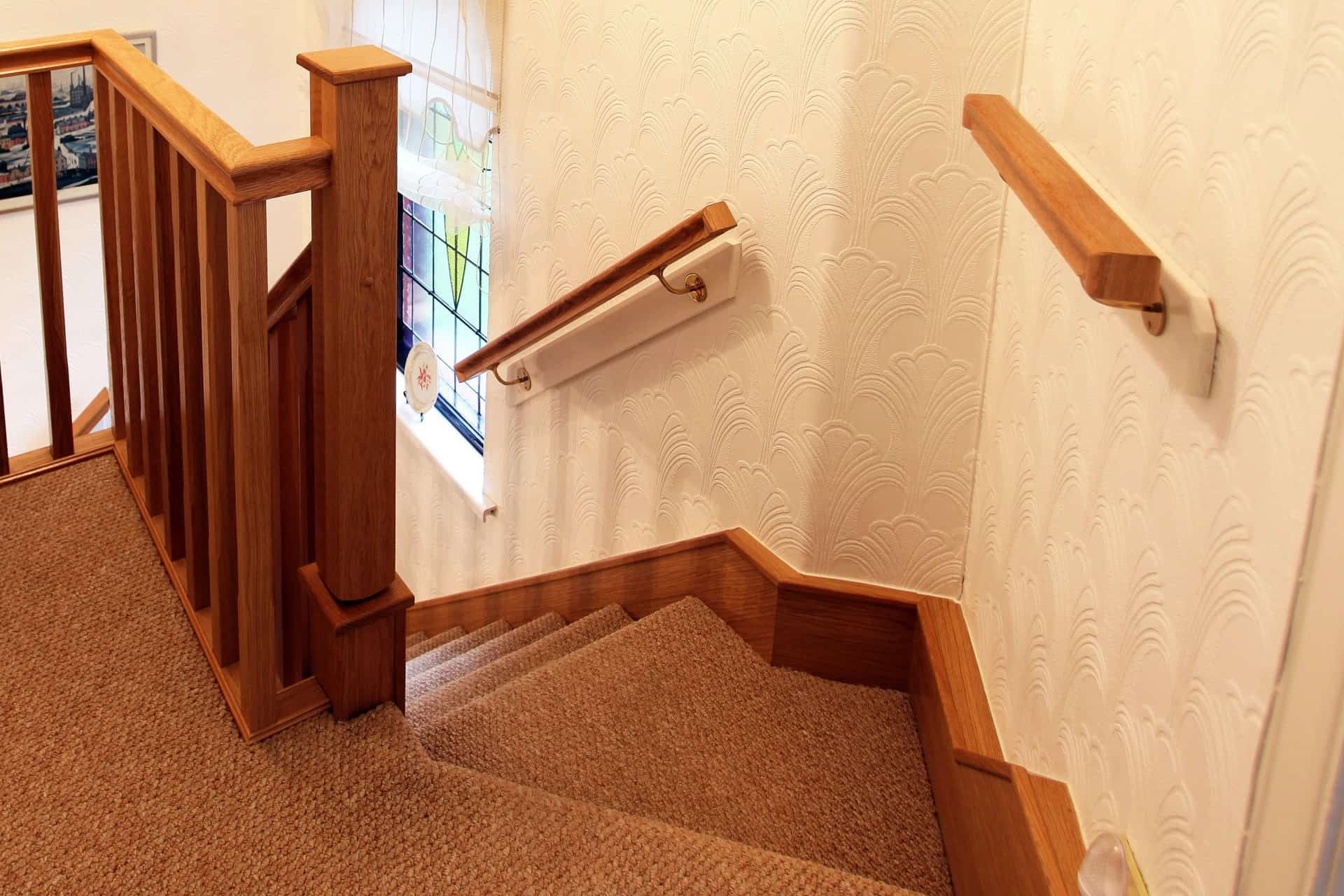 Wall mounted handrails offer extra stability on your stairs we can make a handrail in any design and finish to match your stairs and decor